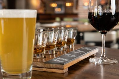 Whiskey flight, a glass of beer and a glass of red wine