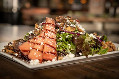 Watermelon salad with candied walnuts and goat cheese
